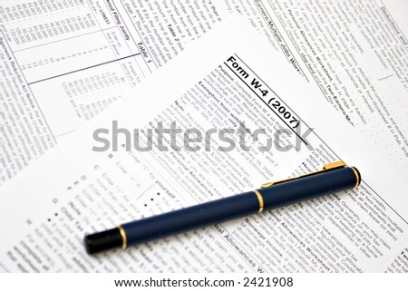 TAX W-4 PREPARATION - stock photo