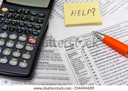 taxation concept: form with calculator, money, pen - stock photo