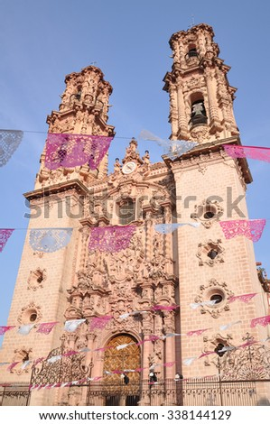 taxco cattedrale front view with flags decorating party - stock photo