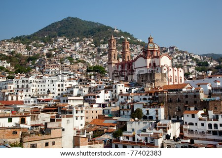 Taxco houses and beautiful church in Taxco, Mexico - stock photo