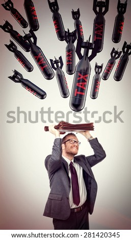 taxes boms and scary businessman - stock photo