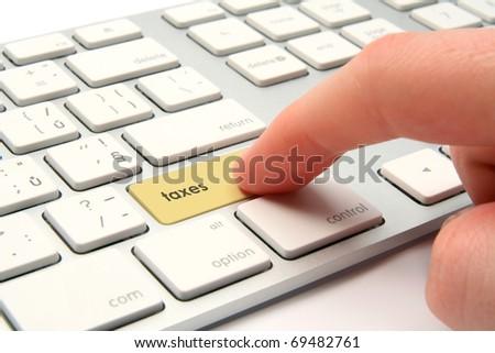 Taxes concept - keyboard with taxes button - stock photo