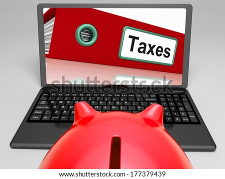 Taxes Laptop Meaning Paying Due Tax Online - stock photo
