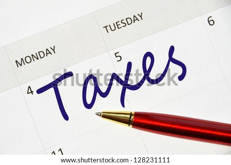 Taxes note in the agenda - stock photo