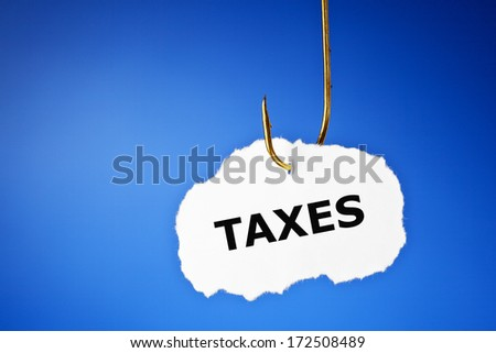 Taxes printed on a piece of paper hooked on a fishing hook. - stock photo
