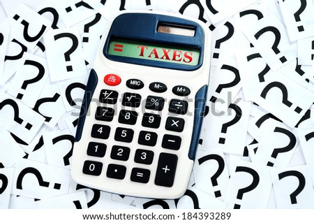 Taxes result on question mark background - stock photo