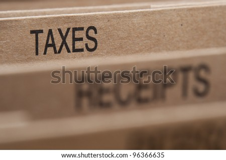 Taxes section tab in folding file. - stock photo