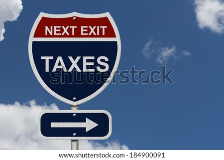 Taxes this way, Blue and Red Interstate Sign with word Taxes and an arrow with sky background - stock photo