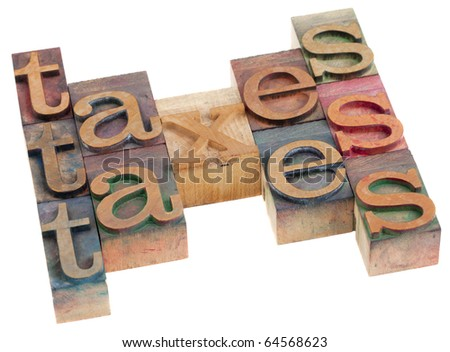 taxes word abstract in vintage wooden letterpress printing blocks isolated on white