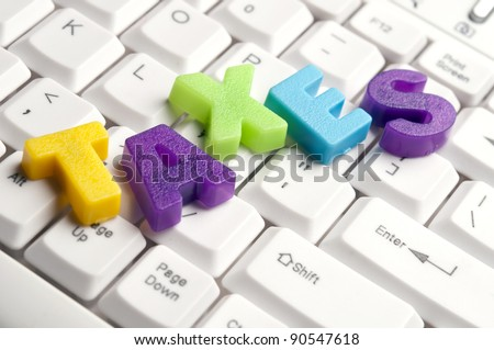 Taxes word made by colorful letters on keyboard - stock photo