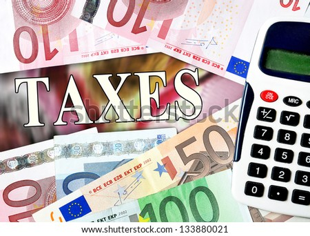 Taxes word with money background