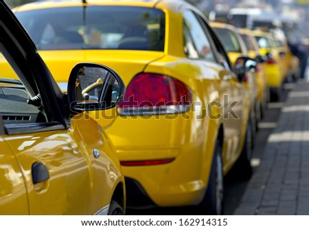 Taxi cabs lined up waiting for customers - stock photo