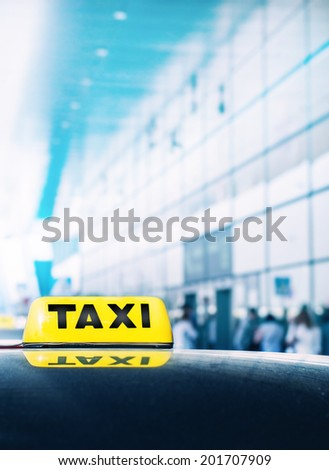 Taxi car near airport gate - stock photo