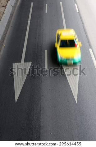 taxi car on street with arrow direction - stock photo
