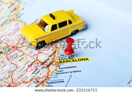 taxi car  toy on  Barcelona ,Spain  map and red pin - Travel concept - stock photo