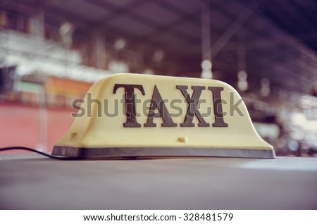 Taxi cars are waiting in row on the street - selective focus in thailand - stock photo