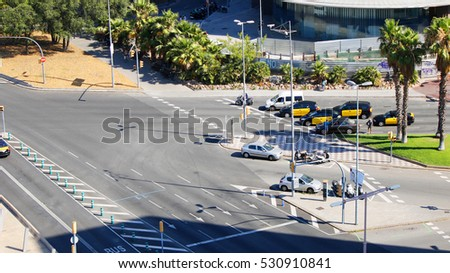 Taxi cars on a road crossing, Barcelona, Spain, July 2016