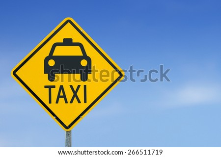 Taxi icon yellow road sign on sky background