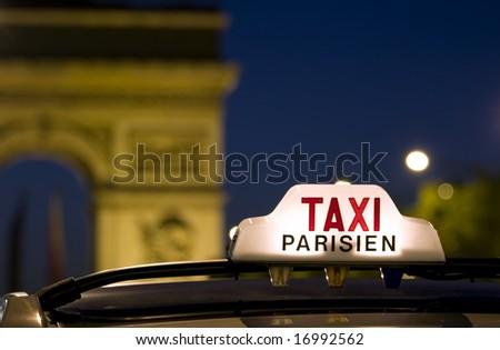 Taxi near the Arc De Triomphe in Paris - stock photo