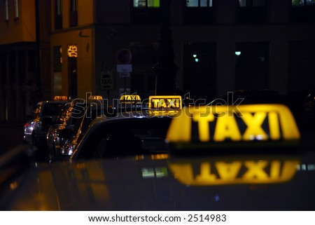 taxi rank at night - could be anywhere... - stock photo