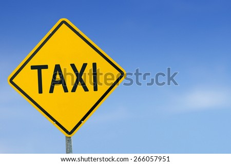 Taxi road sign on sky background
