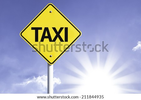 Taxi road sign with sun background  - stock photo