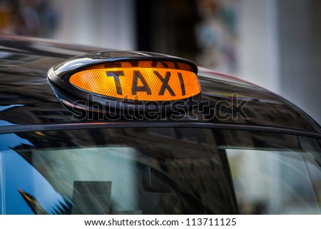 Taxi sign in UK - stock photo