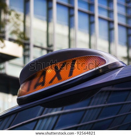 Taxi sign on Cab in Canary Wharf, London - stock photo