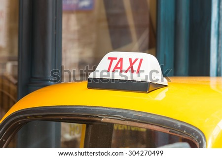 Taxi sign on roof top car - stock photo