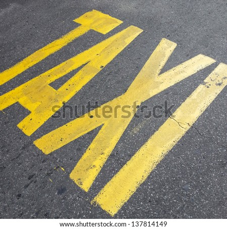 Taxi sign on street - stock photo