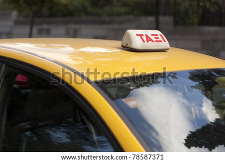 Taxi sign on yellow taxi in Athens, Greece. - stock photo