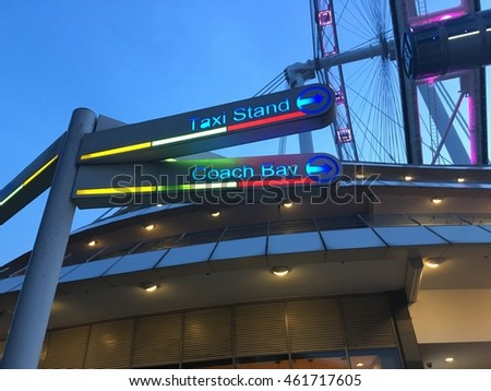 taxi stand and coach bay. Light Signs for direction at singapore flyer.