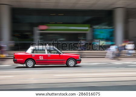 Taxi travel at business district of Hong Kong - stock photo