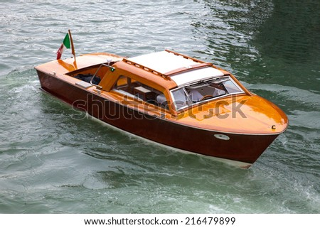 taxi Venice, navigating the channels - stock photo