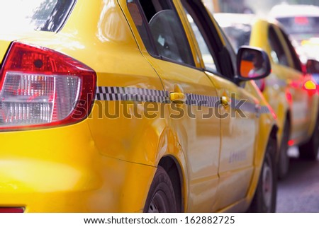 taxi yellow cab on street - stock photo