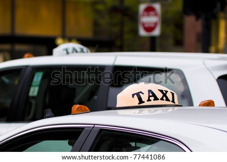 Taxicab Car Top in a big city. - stock photo
