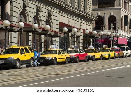 Taxis Waiting in line for customers - stock photo