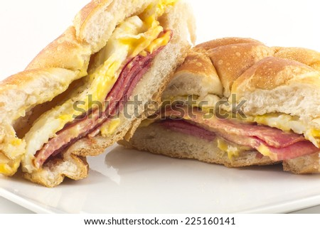Taylor ham, pork roll, egg and cheese breakfast sandwich on a kaiser roll with salt pepper and ketchup, from New Jersey - stock photo
