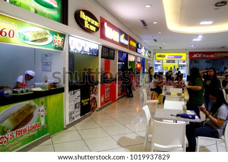 TAYTAY, RIZAL, PHILIPPINES - JANUARY 29, 2018: Food kiosks inside a commercial shopping mall.