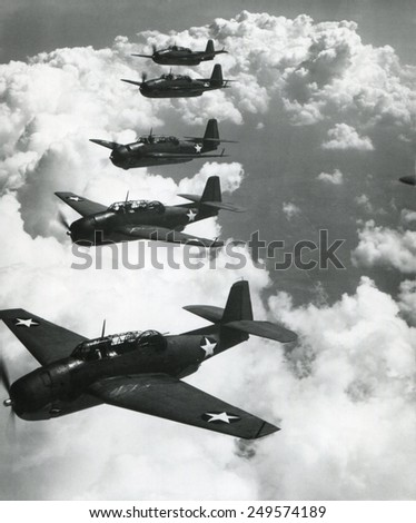 TBF Avengers flying in formation over Norfolk, Va. Photo by Lt. Comdr. Horace Bristol, who became a noted photographer after the war.Sept. 1942. - stock photo
