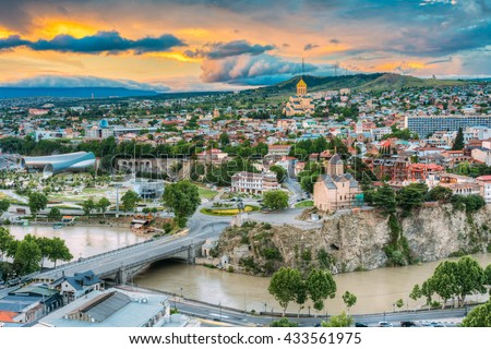 Tbilisi At Sunset, Georgia. Summer Cityscape. On Photograph Visible A New Concert Hall, Avlabar Residence - Presidential Administration Of Georgia, Holy Trinity Cathedral Of Tbilisi, Metekhi Church - stock photo