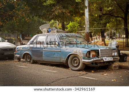 TBILISI, GEORGIA - AUGUST 16, 2015: Abandoned Mercedes-Benz car on the street of Tbilisi - stock photo