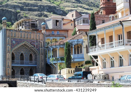 Tbilisi, Georgia - August 06, 2013: Architecture of the Old town of Tbilisi, in Abanotubani district. Dome sulfur baths, mosque Juma and carved balconies in the picture. Horizontal Orient.