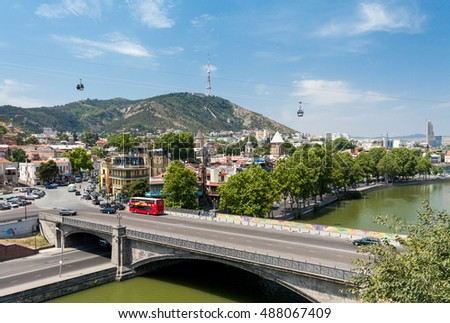 Tbilisi, Georgia - August 1, 2015: You can see oldest disctrict Kala of Tblisi. The Metekha bridge in front of the photo with European Youth Summer Olympic Festival 2015 advertising.