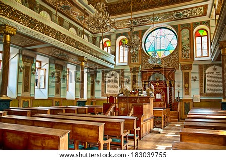 TBILISI, GEORGIA - JULY 15: Interior of the Tbilisi Great Synagogue on July 15, 2013 in Tbilisi, Georgia. The building was built from 1895 to 1903 in an eclectic style by Georgian Jews. - stock photo
