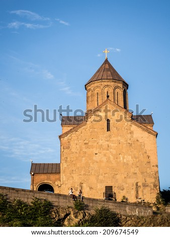 TBILISI, GEORGIA - JUNE 26, 2014: Metekhi church in the old town of Tbilisi, the capital of Georgia, ay sunset. The church was built in the 5th century.