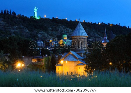 TBILISI, GEORGIA -?? JUNE 12, 2015: View of The Sioni Cathedral of the Dormition and Kartvlis Deda statue at night - stock photo