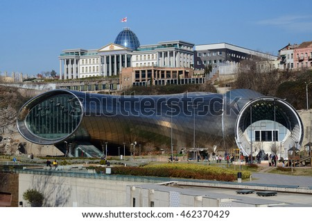 TBILISI, GEORGIA - MARCH 07, 2015: People in park in front of Concert Hall and  Official residence of Georgian President in Tbilisi, Georgia.Tbilisi is a capital and largest city ib country