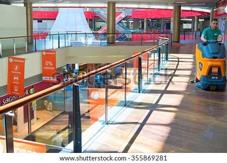 TBILISI, GEORGIA - MAY 05, 2015: Cleaning in progress in Tbilisi shopping mall.The Mall occupies a total of four floors with a GLA of approximately 74,000 square metres - stock photo