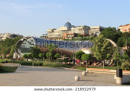 TBILISI, GEORGIA - MAY 15, 2014: View of new concert hall, example of modern architecture. Tbilisi is the capital and the largest city of Georgia, lying on the banks of the Mtkvari River. - stock photo
